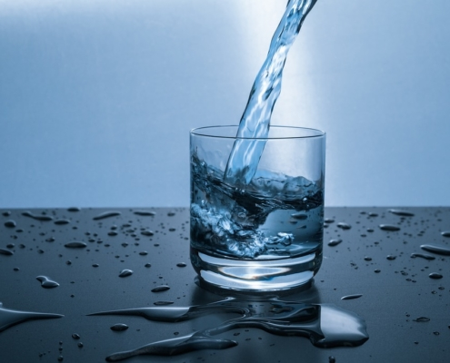 Water Testing Services - glass with water being poured into cup